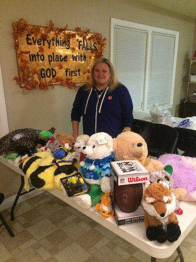 Captain Birks is pictured with some of the donated items.